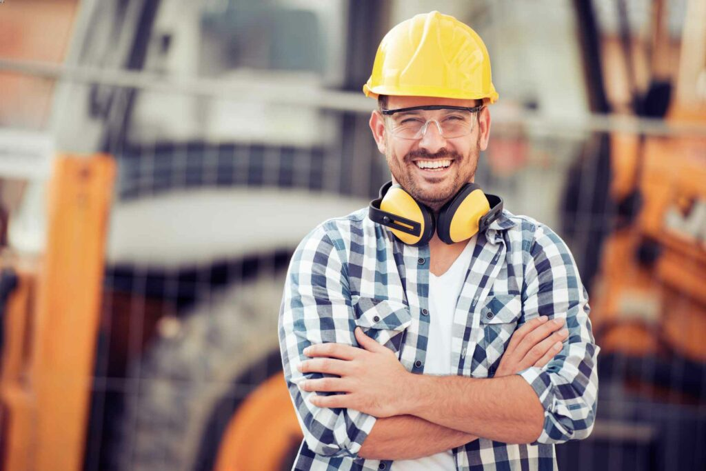 Young construction worker in hard hat